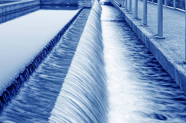Modern urban wastewater treatment plant. Modern urban wastewater treatment plant. sewage treatment plant stock pictures, royalty-free photos & images