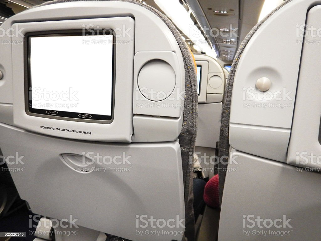 modern vehicle airplane seats with tv stock photo