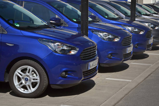 Modern vehicles in a row Warsaw, Poland - 31 August, 2017: Modern Ford Ka Plus vehicles parked on the street on the exhibition point. This model is the first budget car from Ford on the European market. vehicle brand name stock pictures, royalty-free photos & images