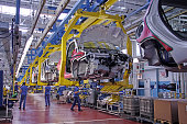 Tychy, Poland - June, 16th, 2011: Cars production line in Fiat factory in Poland. The assembly plant ensures both the production of the Fiat range models (Panda II, 500), Lancia/Chrysler Ypsilon and Ford Ka. The manufacturing line was adapted for an annual capacity of 600,000 cars.