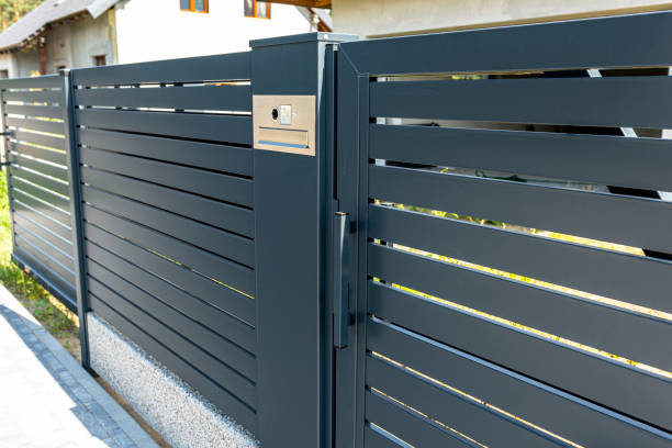 a modern videophone with a letterbox and a wireless card reader, mounted in panel fence in anthracite color, visible wicket. - going inside eye imagens e fotografias de stock