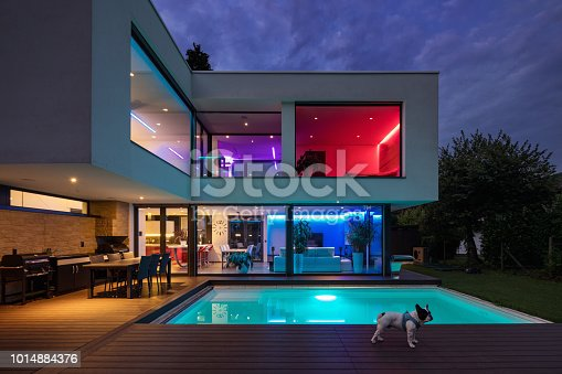 istock Modern villa with colored led lights at night 1014884376