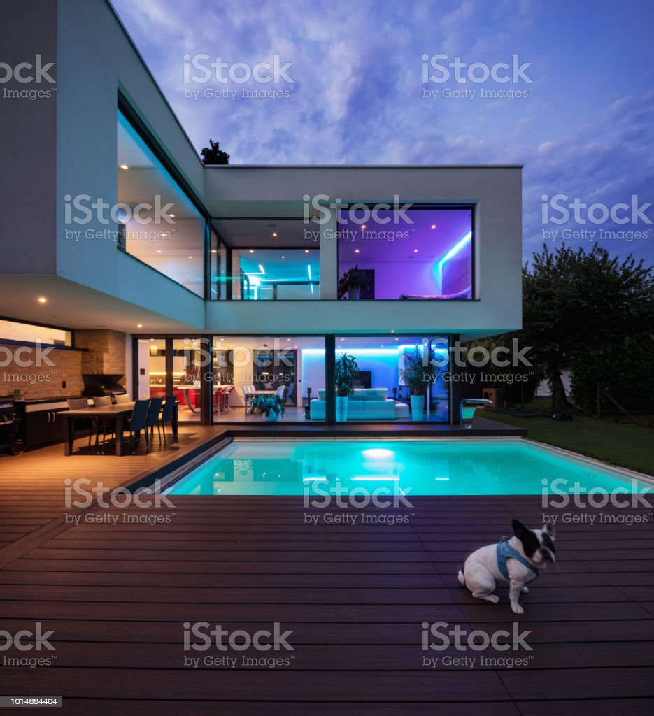 Modern villa with colored led lights at night stock photo