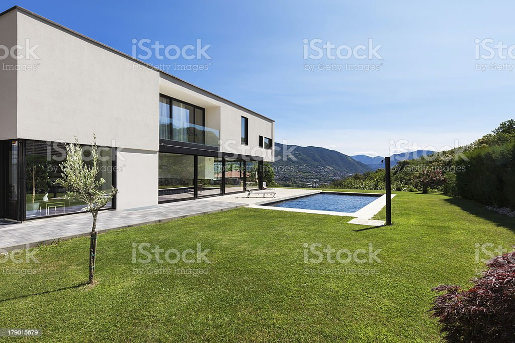 Modern villa with lawn and pool stock photo