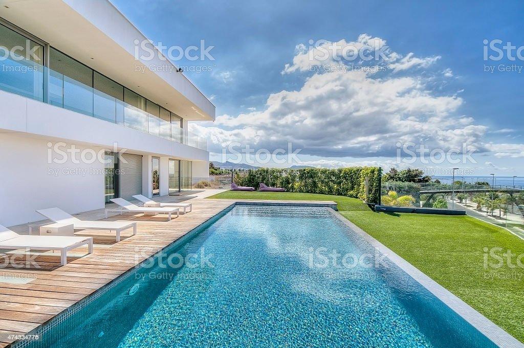 Modern villa with swimming pool stock photo