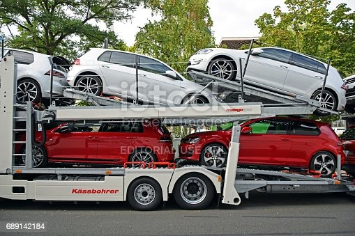 istock Modern Volkswagen Golf vehicles on the car transporter 689142184