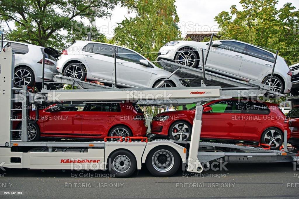 Modern Volkswagen Golf vehicles on the car transporter stock photo