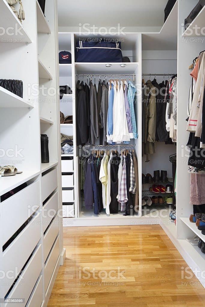 Modern walk in wardrobe vertical stock photo