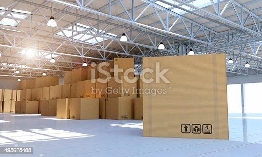 istock Modern warehouse full of goods with one customizable cardboard box 495625488