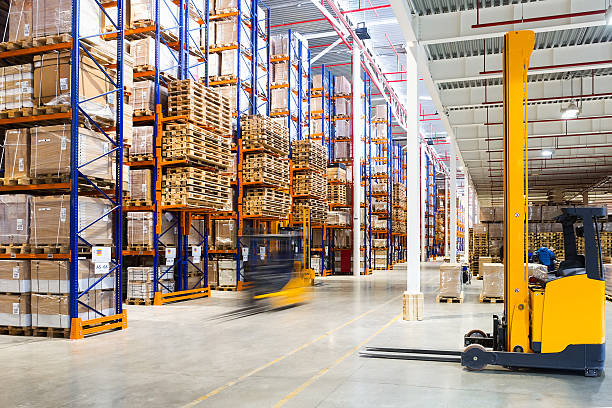 modern warehouse interior - warehouse stock photos and pictures