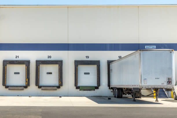 Modern warehouse loading zone and a trailer stock photo