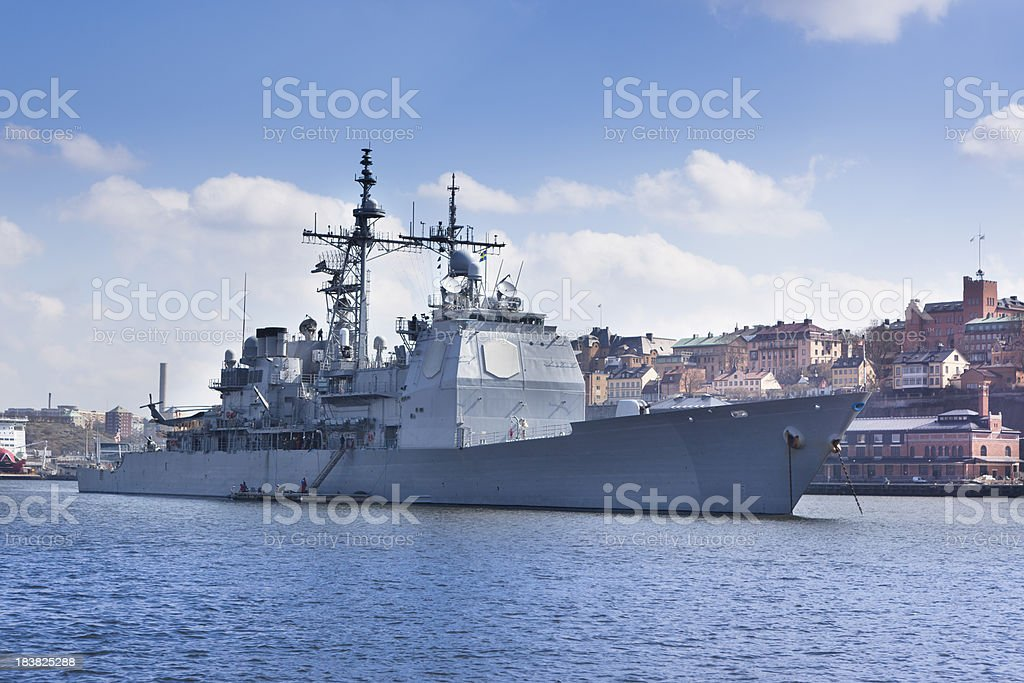 Modern warship in harbour stock photo