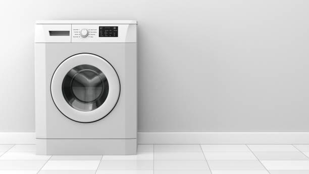 moderne waschmaschine vor weißer wand - waschmaschine fotos stock-fotos und bilder