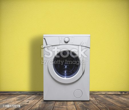 istock Modern washing machine in laundry room interior 1156172219