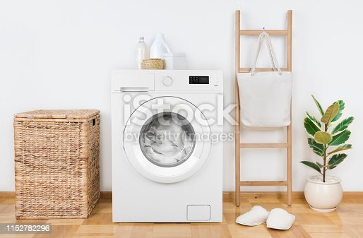 istock Modern washing machine with basket in laundry room interior 1152782296