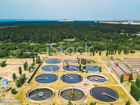 Modern wastewater treatment plant, top view from drone, sedimentation drainage tanks round form.