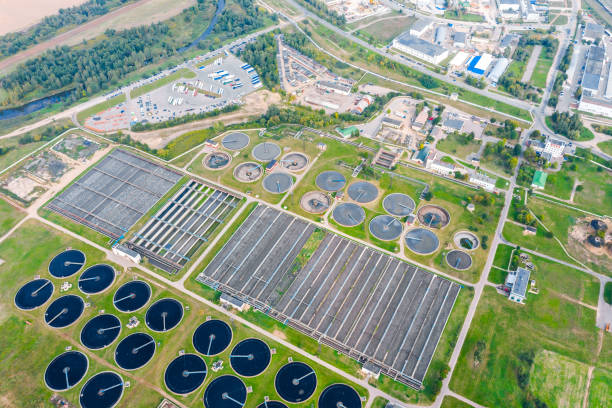 modern wastewater treatment plant with round tanks for recycling dirty sewage water. aerial view stock photo