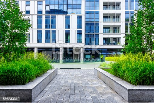 889473004 istock photo Modern white and blue apartment building 876233312