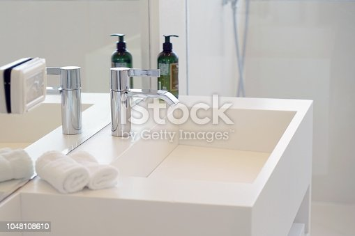 istock Modern white bathroom sink with faucet 1048108610