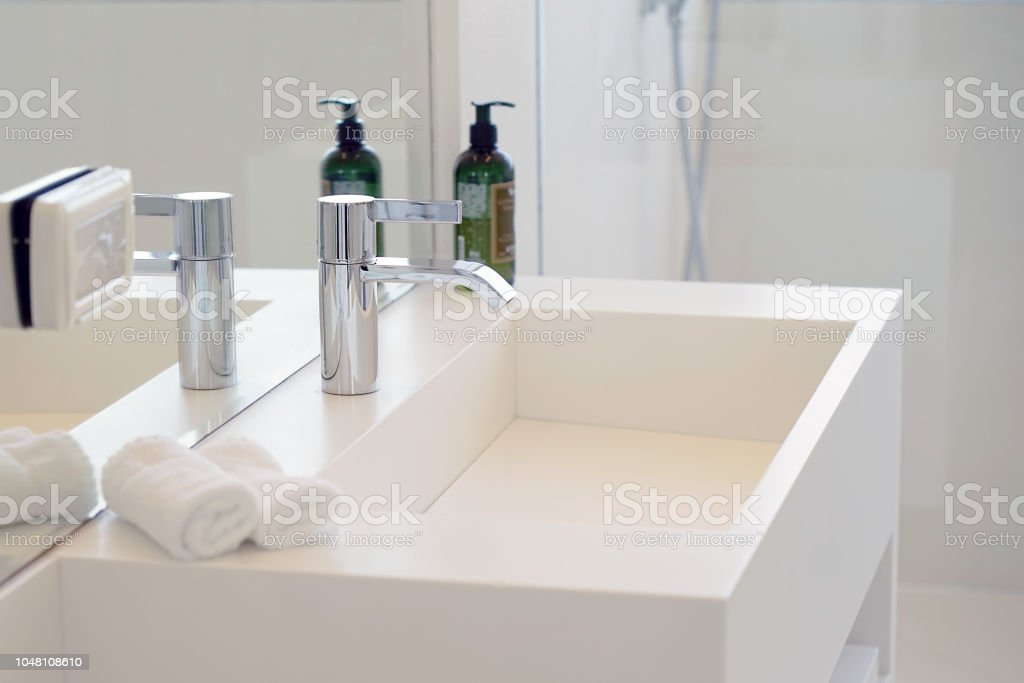 Modern white bathroom sink with faucet stock photo