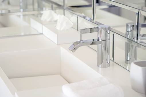 istock Modern white bathroom sink with faucet 1048108624