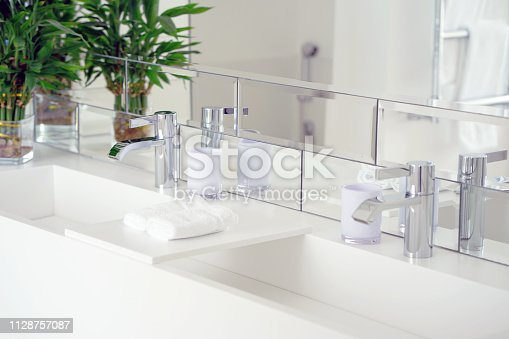 istock Modern white bathroom sink with faucet 1128757087