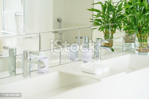 istock Modern white bathroom sink with faucet 1161532382