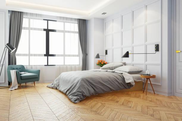 chambre lit blanc moderne, roi lit avec feu noir et tables de chevet bois sur parquet et mur blanc, rendu 3d - étage photos et images de collection