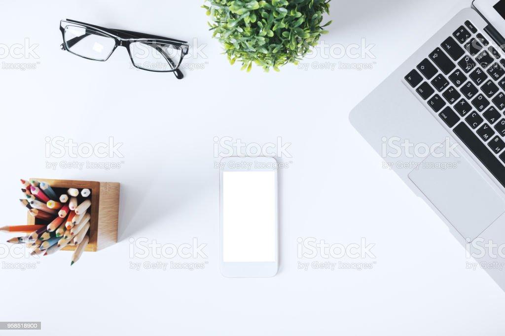 Modern white desktop with items stock photo