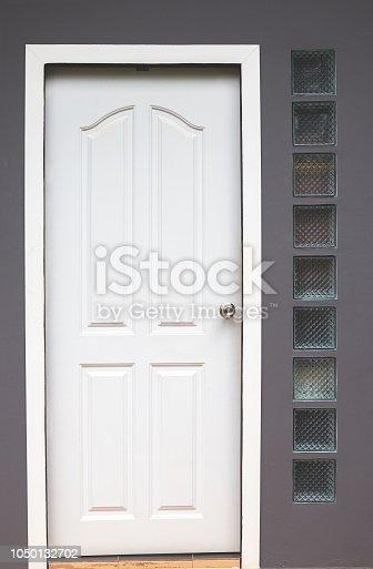 922736646 istock photo Modern white door. Grey wall with free space. Minimalist bright interior 1050132702