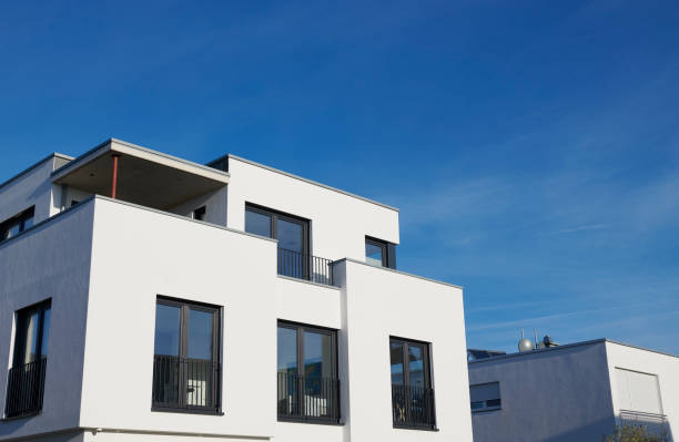 Modern white family house and blue sky stock photo