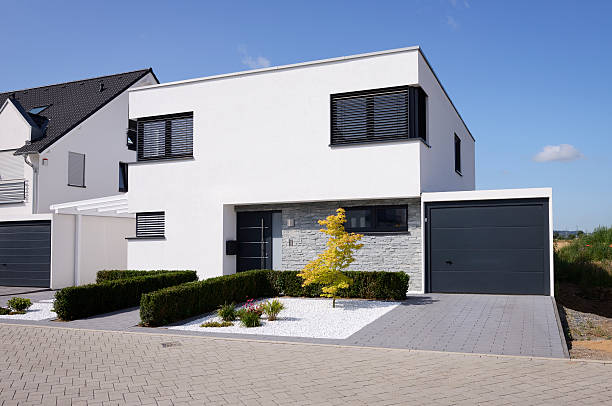 Modern white house with garage Сologne, Germany - July 6, 2015: Modern one-familiy house in the new housing area of Cologne-Widdersdorf. detached house stock pictures, royalty-free photos & images