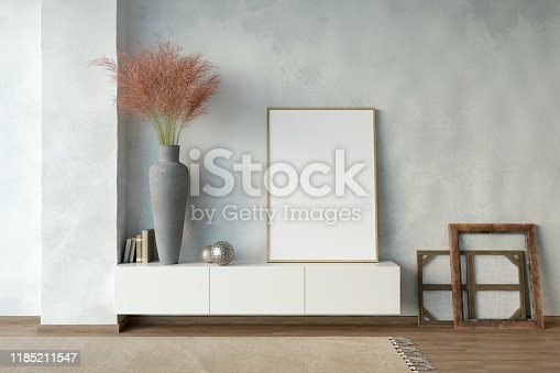 istock Modern white interior with a mock-up poster, a pedestal, a vase with field spikelets, picture frames. 1185211547