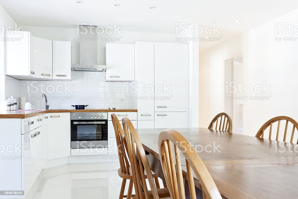 Modern White Kitchen In A House With Dining Table And Chairs Stock Photo Download Image Now Istock