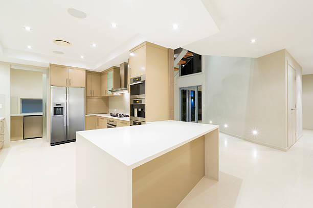 Modern white kitchen in new luxurious home stock photo