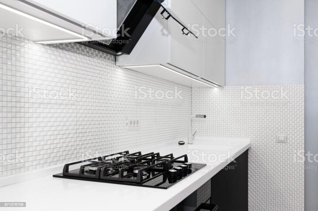 Modern white kitchen Modern white and black kitchen, minimalistic clean design Air Duct Stock Photo