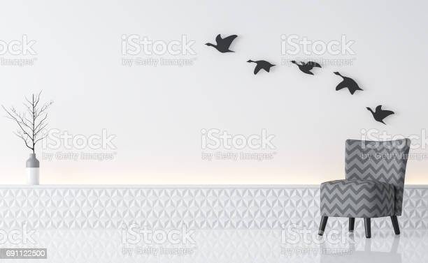 Modern white living room interior minimalist style image 3d rendering .There are gray armchair,white wall and decorate wall with black metal work