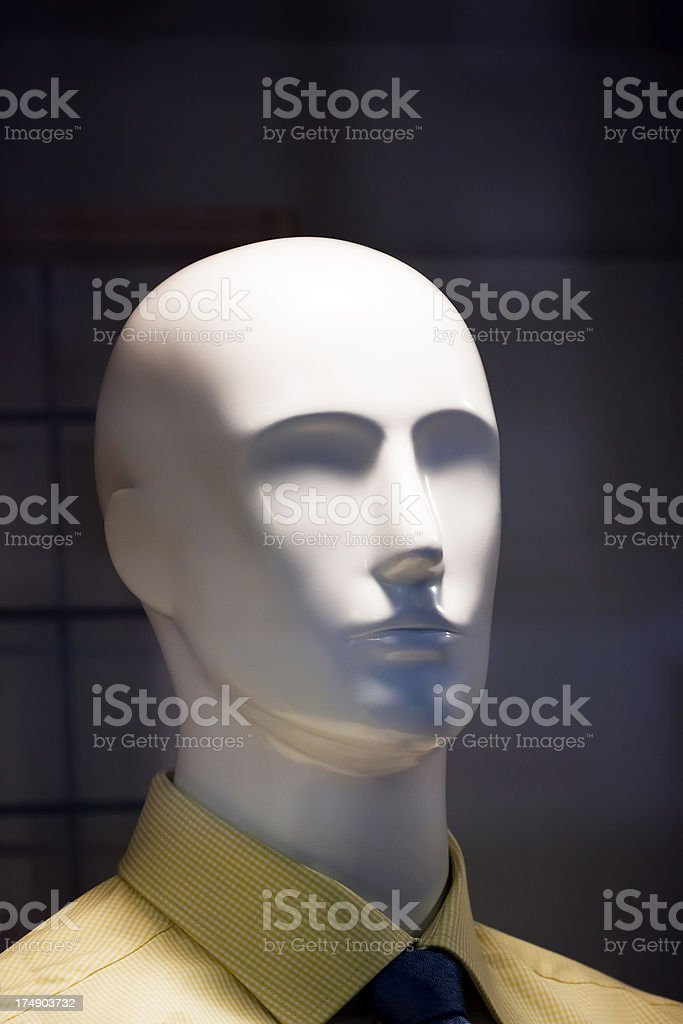 Modern white male mannequin head against dark background, copy space royalty-free stock photo
