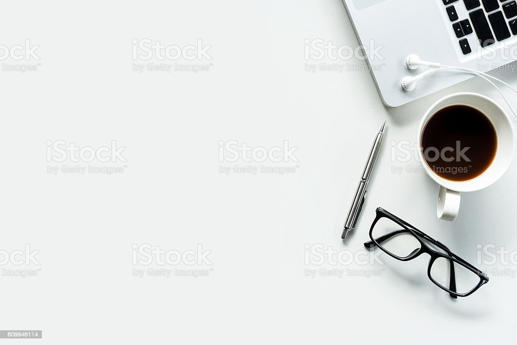 office desk photo. Modern White Office Desk Table With Laptop. Stock Photo