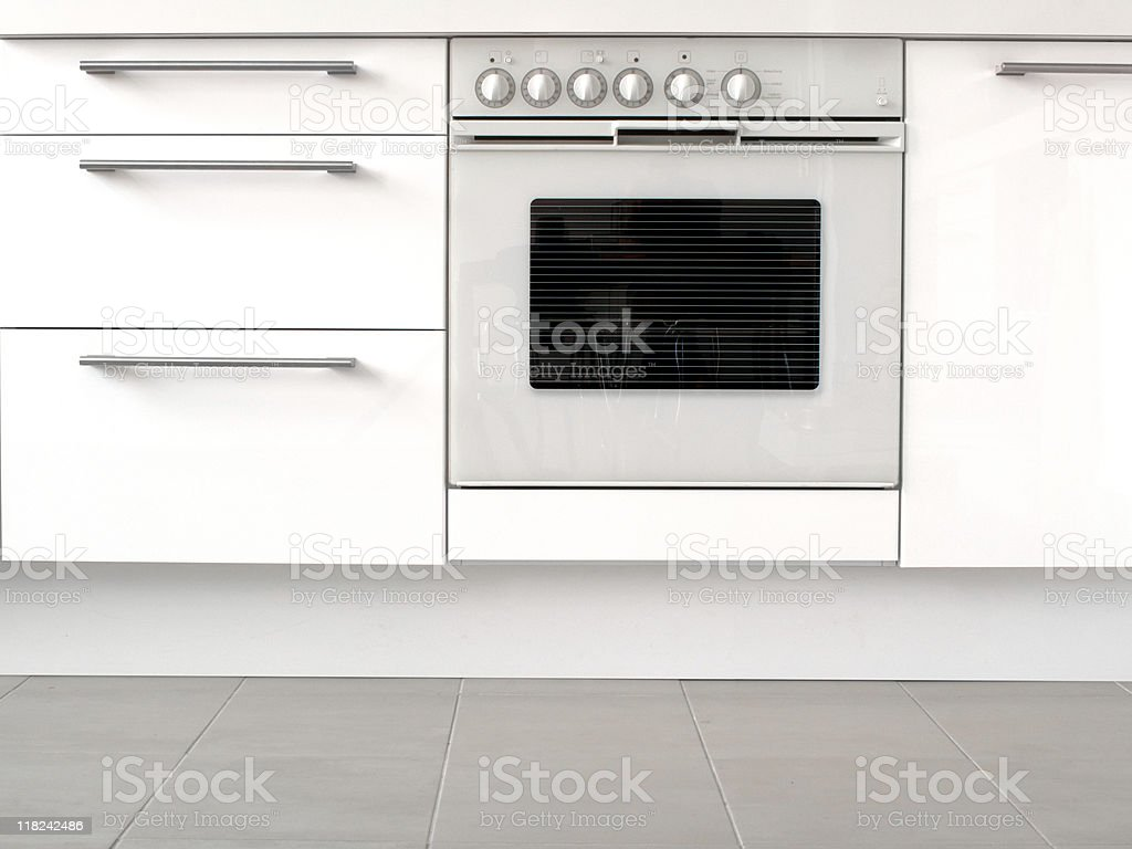 Modern White Oven and Kitchen Cabinets royalty-free stock photo