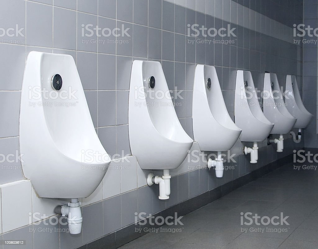 Modern white restroom interior with urinal row stock photo