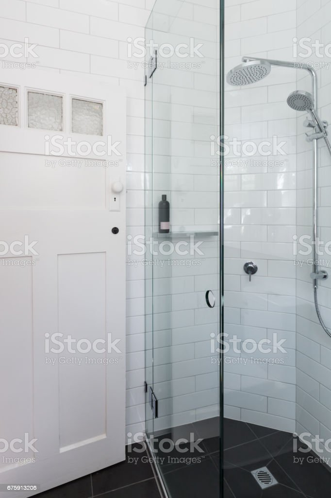 Modern white shower in bathroom renovation with brick pattern tiling stock photo