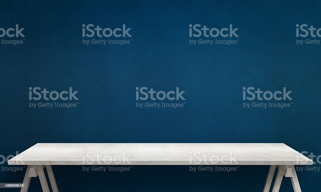Modern white table with legs and free space stock photo