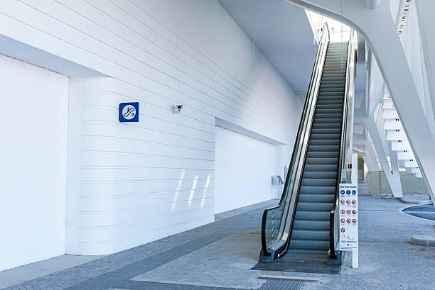 Modern White Train Station Entrance with Escalator stock photo