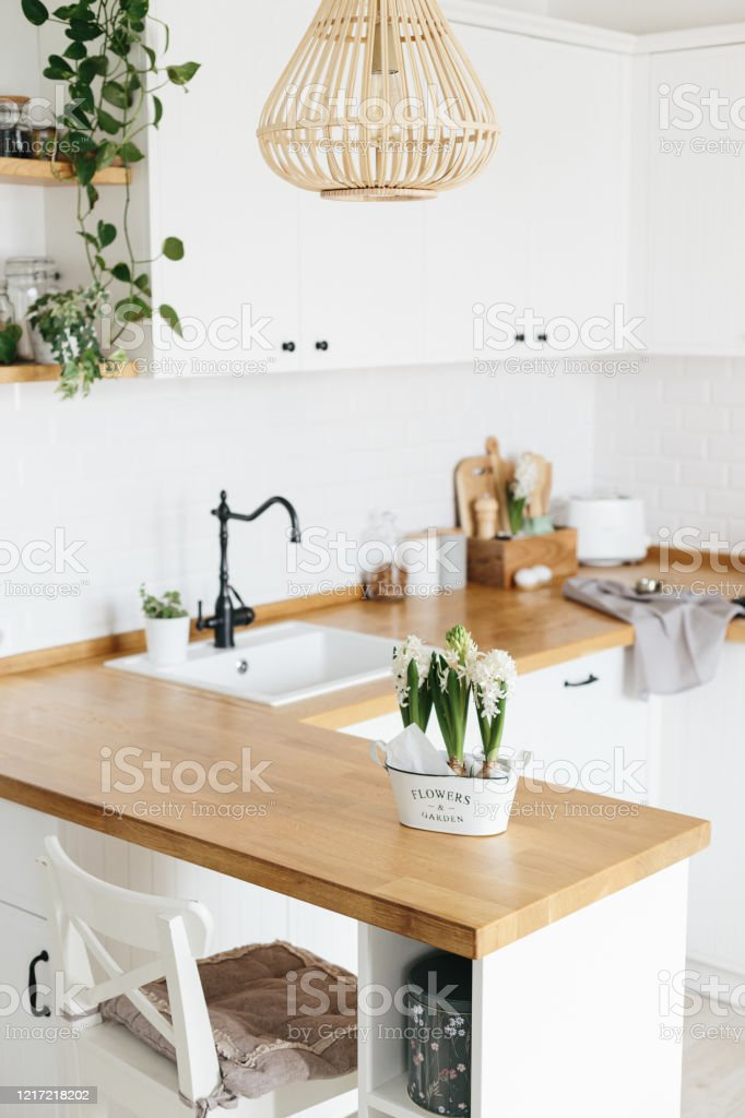 Modern White Ushaped Kitchen In Scandinavian Style Spring Decoration Spring Flowers Stock Photo Download Image Now Istock