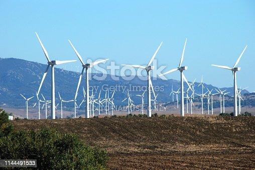 Tall white modern wind generators in a field, near Tarifa, Costa de la Luz, Cadiz Province, Andalusia, Spain, Europe.
