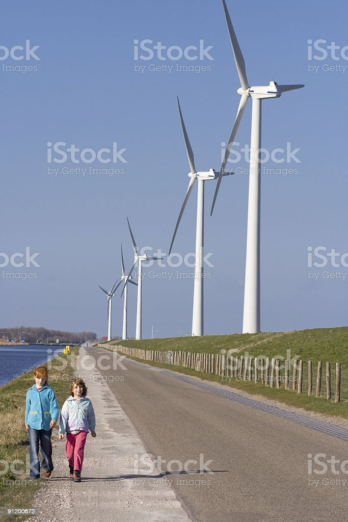 Modern windmills in The Netherlands on dike stock photo