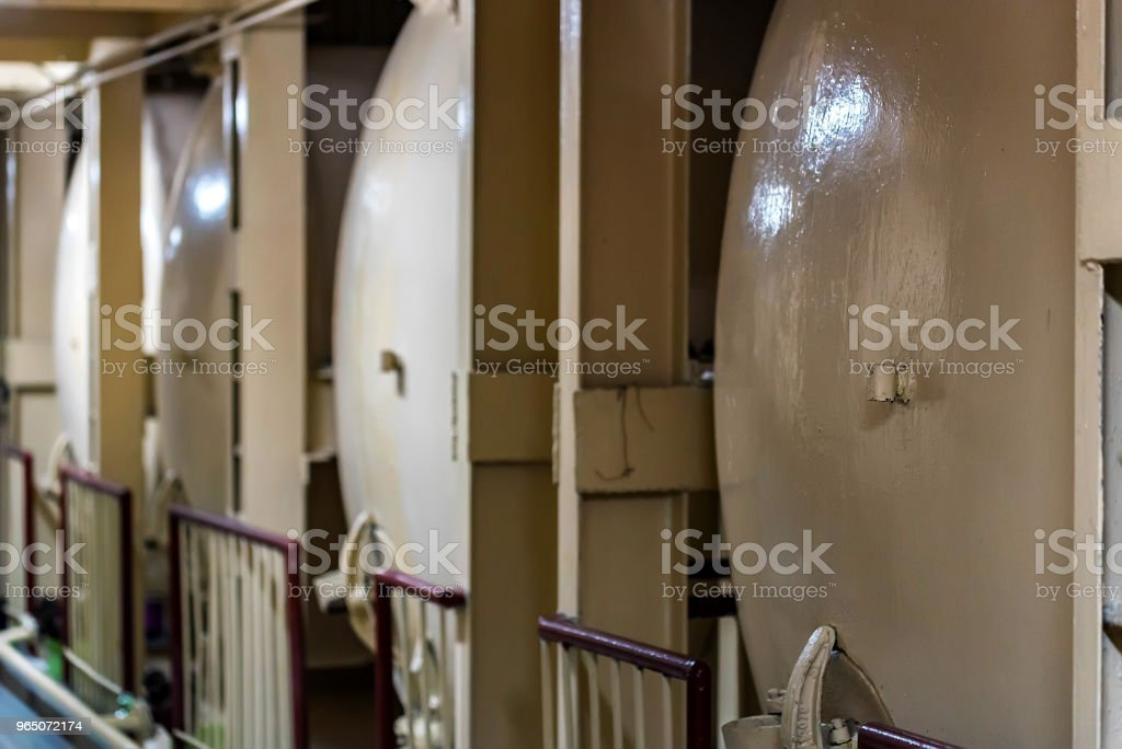 Modern winery interior with wine tanks royalty-free stock photo
