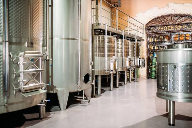 Modern winery with big steel barrels stock photo