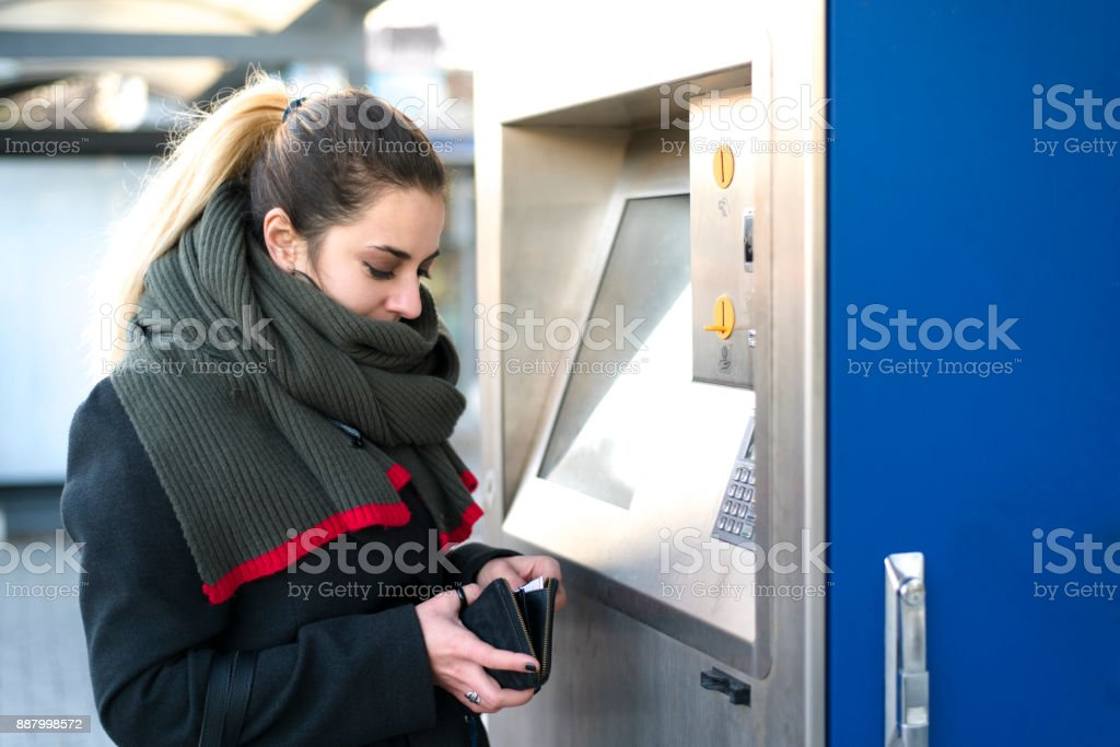 Modern woman buying a bus ticket stock photo